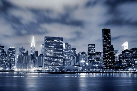 Midtown Manhattan skyline At Night Stock Photo