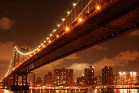 Manhattan Bridge and Manhattan skyline At Night Stock Photo - 4900594