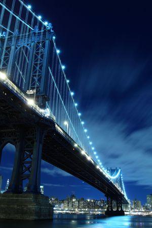Manhattan Bridge and New York City Skyline At Night