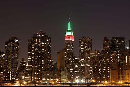 empire: The Empire State Building in Christmas Lights and New York City skyline