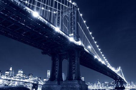 New York City Skyline and Manhattan Bridge At Night Stock Photo - 6834702