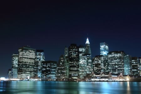 New York City Skyline and Manhattan Bridge At Night LANG_EVOIMAGES