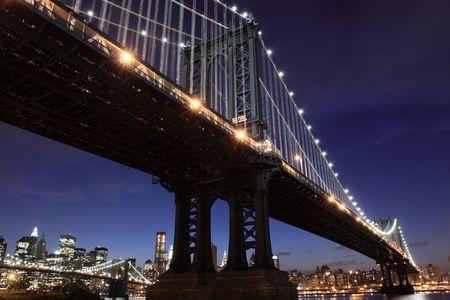 New York City Skyline and Manhattan Bridge At Night  Stock Photo - 7086547