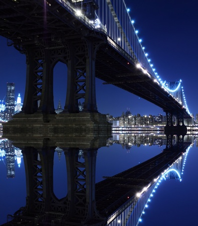New York City Skyline and Manhattan Bridge At Night  版權商用圖片