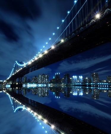 Manhattan Bridge and Manhattan skyline At Night Lights, New York City