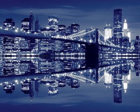 city lights: Brooklyn Bridge and Manhattan Skyline At Night, New York City  LANG_EVOIMAGES