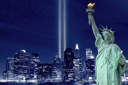 memorial: lowers manhattan skyline, the towers of lights and the statue of liberty at night
