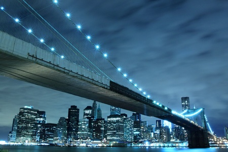 urban scenics: Brooklyn Bridge and Manhattan Skyline At Night, New York City  LANG_EVOIMAGES