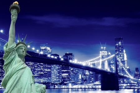 manhattan skyline, brooklyn bridge and the statue of liberty at night lights, new york city  Stock Photo