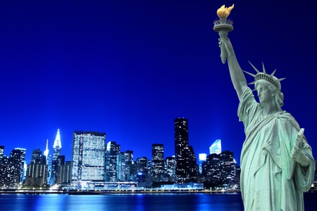 manhattan skyline and the statue of liberty at night lights, new york city  Stok Fotoğraf