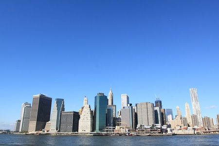urban scenics: Lower Manhattan Skyline and Skyscrapers on a Clear Blue Sky from Brooklyn, New York City