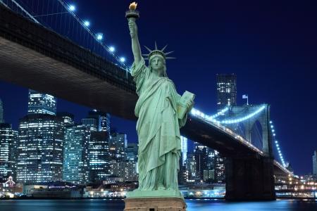 brooklyn bridge: Manhattan Skyline, Brooklyn Bridge and The Statue of Liberty at Night Lights, New York City  LANG_EVOIMAGES