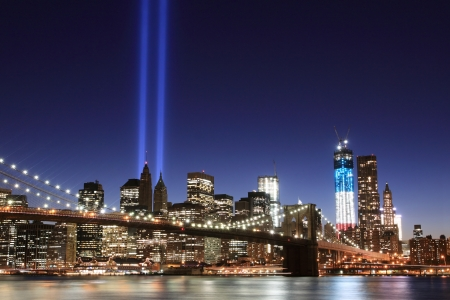Brooklyn Bridge and the Towers of Lights (Tribute in Light) at Night, Manhattan, New York City Stock Photo