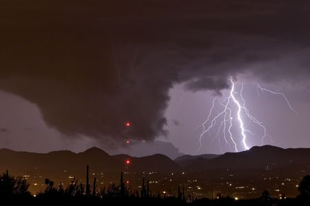 thundershower: Wall cloud or funnel cloud with lightning during severe thundershower in desert southwest United States