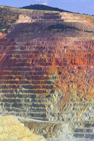 A cliff face of an open pit copper mine in southwestern United States