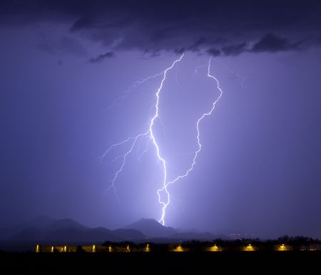 thundershower: Lightning over the Tortolita Mountains with airplane hangers in the foreground Stock Photo