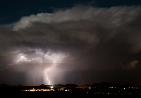 thundershower: A late night thunderstorm develops over the Roskruge Mountains