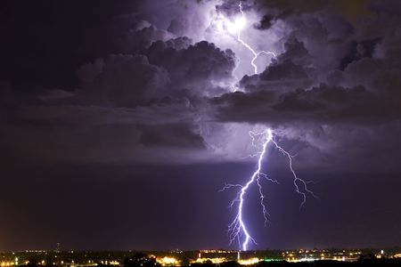 extreme weather: A thunderhead is illuminated by a lightning bolt