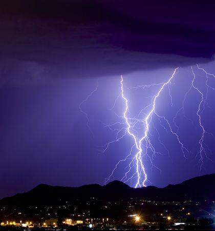 Lightning bolts hitting the Tucson Mountains photo