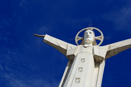 a statue of Christ at the top of the mountain photo