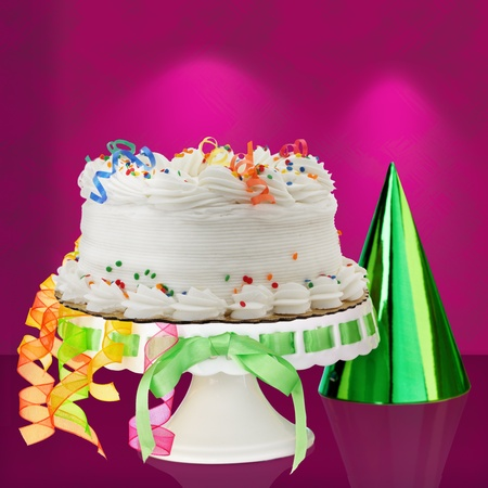 icing sugar: Delicious White Vanilla Birthday Cake With Red, Blue, Green, Yellow and Orange Confetti Decorations ~ Over Stock Photo