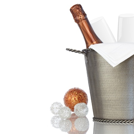 Elegant Champagne and Crystal Glass Flutes Chilling in Texured Hammered Metal Wine Bucket With Bronze & Silver Holiday Decorations Archivio Fotografico
