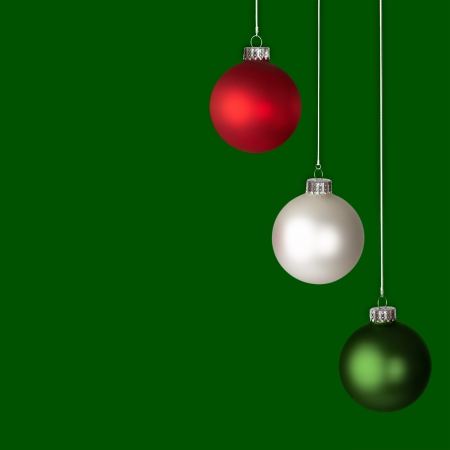 White, Red and Green Christmas Ornaments Isolated On Green Background  photo