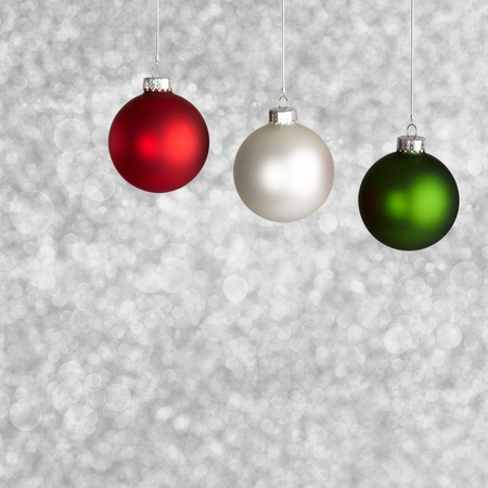 stock photo white red and green christmas ornaments on silver bokeh background - Red White Green Christmas Decor