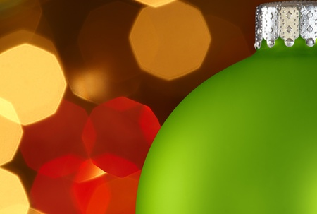 Blue Christmas Ornament Over Colorful Golden Red Christmas Lights Bokeh Background