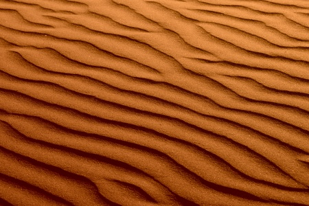 Rippled Red Brown Beach Sand Dune Texture Background