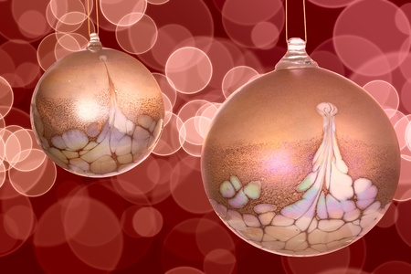 Golden White And Pink Christmas Ornaments On Colorful Red and Pink Bokeh Light Background photo