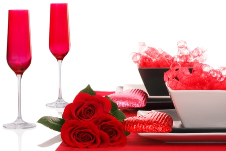 Isolated; Romantic Modern Black & White Table Setting ~ Red Champagne Flutes with Fresh Red Roses Stockfoto