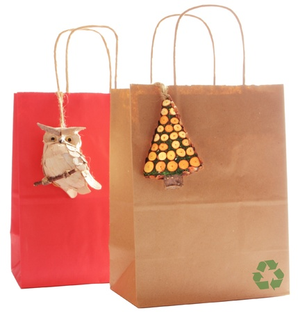 Two gift bags made fo recycled paper, decorated with natural wood ornaments Stock Photo