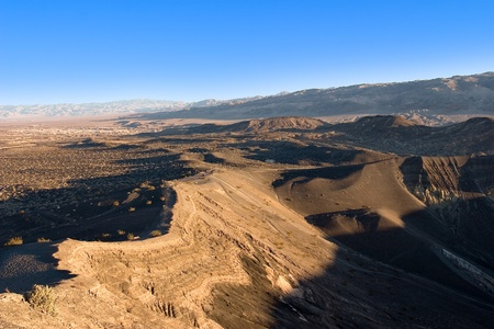 blasted: Ubehebe Crater In Death Valley is part of the youngest volcanic feature which erupted two thousand years ago over the fault along the western base of Tin Mountain. The crater is over a half a mile wide and 770 feet deep. Up to 150 feet of rock debris mant