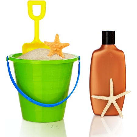 Beach Accessories ~ Colorful Green & Blue Pail Filled With White Sand And Yellow Shovel , Starfish Shells And Sunscreen   photo