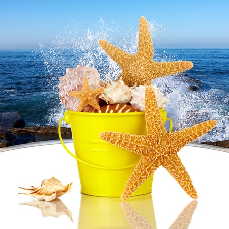 Day Spa Still-life Wtith Starfish And Sea Shells In Colorful Yellow Beach Bucket On White Glass Table photo