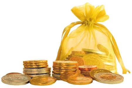 Coin Bag & Pile di Gold e Silver monete di cioccolato Archivio Fotografico - 11550375
