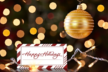 Gold Christmas Ornament And Colorful Red Striped Happy Holiday Card ~ Christmas Lights Bokeh Background