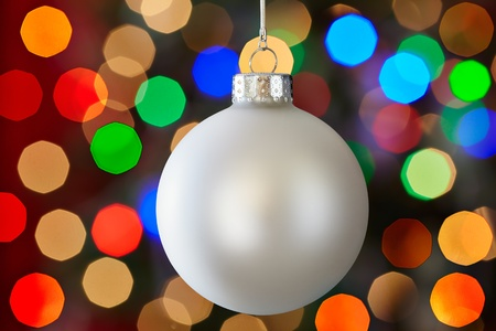 White Christmas Ornament Over Colorful Multicolored Christmas Light Background Stock Photo - 11550337