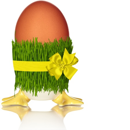 Brown Holiday Egg With Yellow Feet. Wrapped In Grass Skirt Isolated On White Background photo