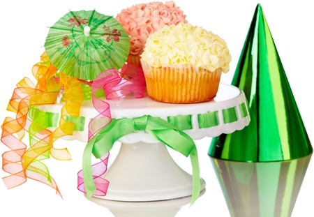 Delicious Raspberry And Vanilla Cupcakes On Cake Stand With Party Hat And Colorfull Ribbons Stock Photo - 11550304