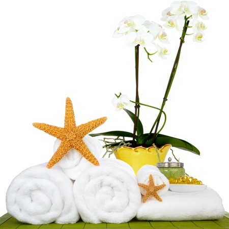 fish spa: Day Spa Still-life Wtith Bath Beads, Sea Salt and Starfish On Green Bamboo Mat