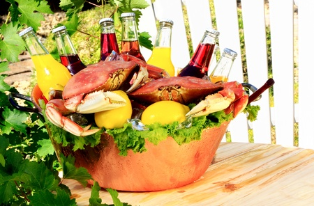Cooked Red Dungeness Crabs In Copper Bucket With Assorted Flavored Pop or Sodas, Orange, Cranberry, Lemon, Berry Stock Photo