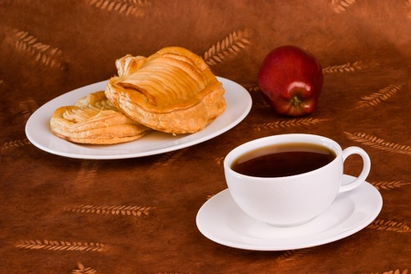 Glazed French Apple Pastry and Coffee or Tea  Archivio Fotografico