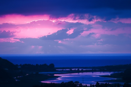 Twilight Blue, Mauve And Pink Sunset Overlooking Lagoon And Beach Stock Photo