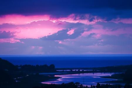 winter sunrise: Twilight Blue, Mauve And Pink Sunset Overlooking Lagoon And Beach Stock Photo