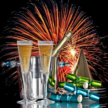 Festive Holiday Fireworks Celebration, Champagne Wine Cooler Bucket With Bottle, Party Hat, Favors and Romantic New Years Drinks photo