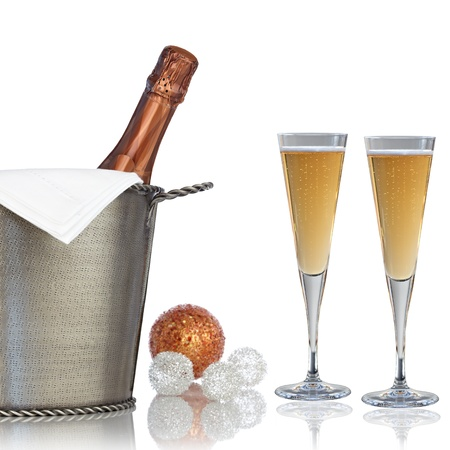 Elegant Bottle Of Champagne with Linen Napkin and Crystal Glass Flutes Chilling in Vintage Textured Hammered Metal Wine Bucket Cooler With Bronze