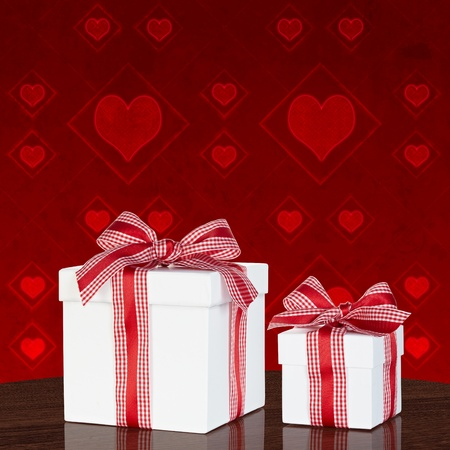 Present In White Gift Box With Red & White Gingham Checked Ribbon Bow On Vintage Table With Valentine Heart Grunge Background Stock Photo - 11869174