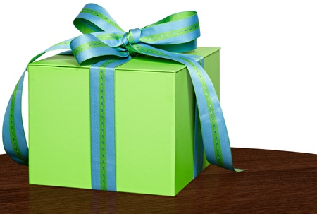Present In Green Gift Box With Blue & Green Striped & Stiched Ribbon Bow On Vintage Wood Table Isolated On White Background Stock Photo - 12110192